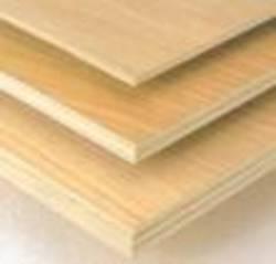 Многослойный строительный материал из дерева