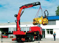Аренда современных манипуляторов для перевозки трактора